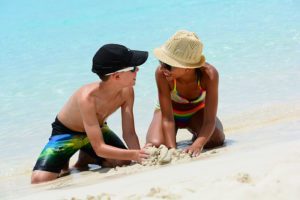 Children making sandcastles - Sandcastle Homes